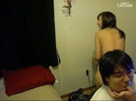 Young Asian girl giving blowjobs in the room in front of her brother