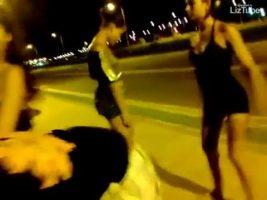Brazilian prostitutes dance in the street